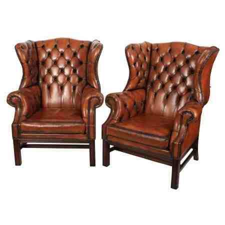 Pair of Large Leather Chesterfield Wing Chairs