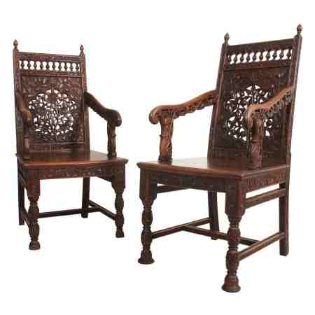 Pair of Anglo Indian Profusely Carved Hardwood Armchairs