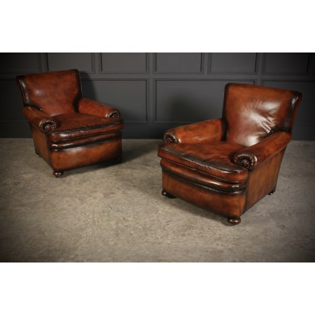 Pair of Hand Dyed Leather Armchairs in the style of Howard & Sons
