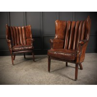 Pair of Quilted Barrel Back Leather Porters Wing Chairs