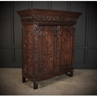 Profusely Carved Oak Cupboard