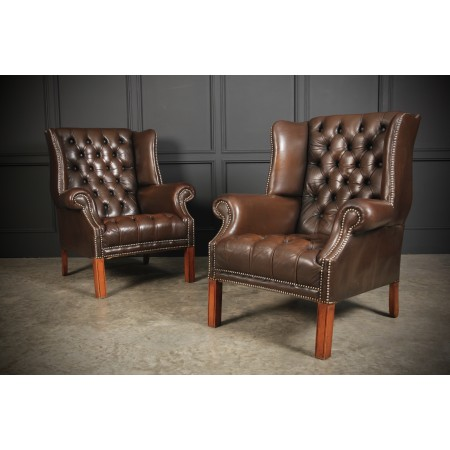 Pair of Buttoned Brown Leather Wing Chairs